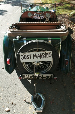 Just married sign and cans on back of antique car