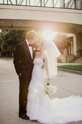 bride in michael faircloth, elbow length veil with blusher, groom in tuxedo
