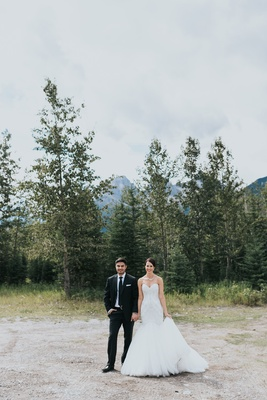 groom in Ermenegildo Zegna, bride in Watters, Banff National Park