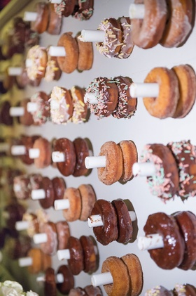 wedding trend donut wall at reception, donut wall instead of wedding cake