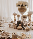 fall wedding ideas pumpkin with place card ribbon gold charger flatware pumpkin centerpiece candles
