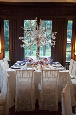 Wintry wedding reception table with purple details