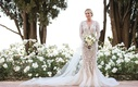 bride in marchesa wedding dress long sleeves v neck mermaid, floral appliques, tulle train