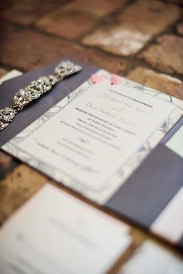 Wedding invitation with purple color silver glitter border on red bricks