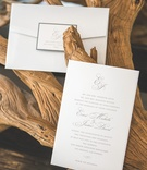 Large white envelope with rectangular seal and invite