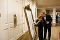Guests find their names on wedding reception chart