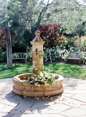 Wedding ceremony outdoor venue Vista, California flowers fresh in fountain