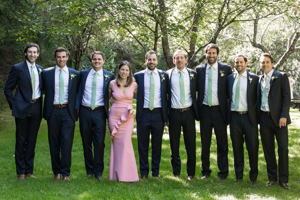 groom with groomsmen in light green ties groomswoman best woman groom sister in pink dress