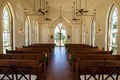 Chapel in Bluffton South Carolina church wedding venue glass windows pews industrial lights simple