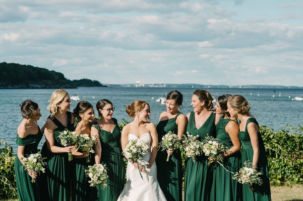 bride bridesmaids deep green dresses bouquets atlantic ocean maine peaks island wedding rustic squad