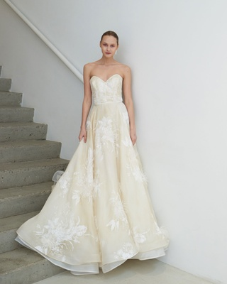 Francesca Miranda Spring 2019 bridal collection Agnes wedding dress ivory strapless feather flowers
