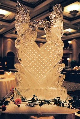 Ice sculpture with birds and heart at wedding reception