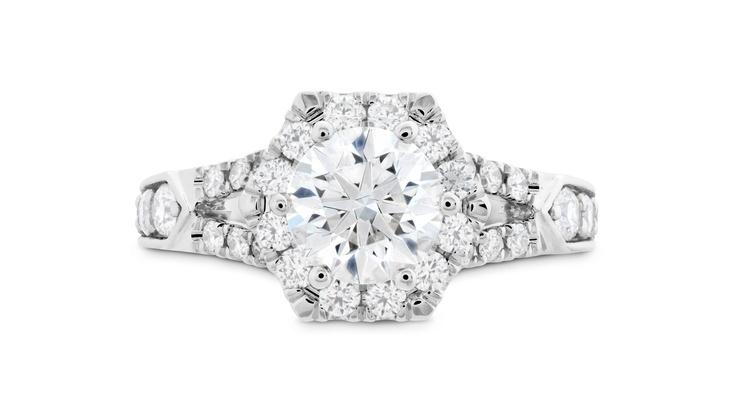 Hearts On Fire hexagonal halo diamond engagement ring with split shank diamond band