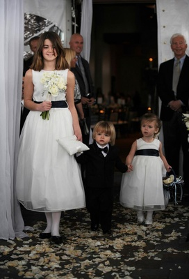 Flower girls holding ring bearer's hand at Idaho ceremony
