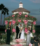 Flowers and greenery decorate gazebo