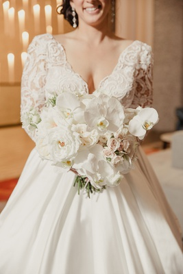 Bride in V-neck wedding dress with rose, orchid bouquet pnina tornai ball gown dress