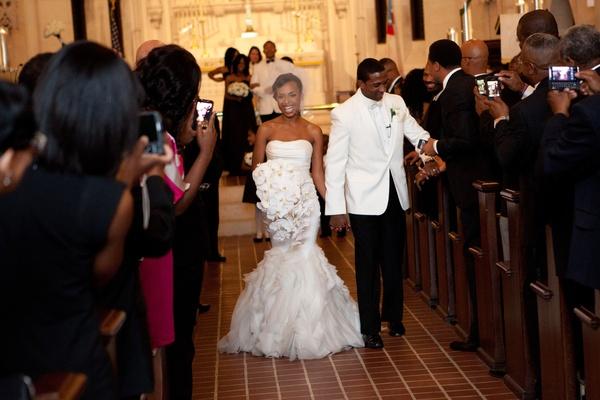 Guests take photos of Jarett Dillard and bride at wedding