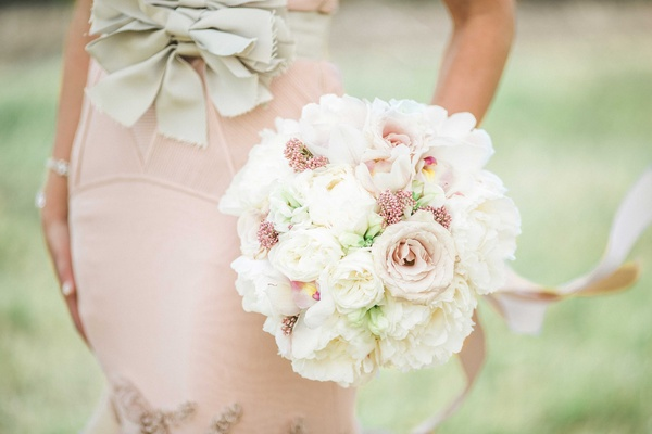 Round bridal bouquet with white garden roses, blush garden roses, blush ribbons