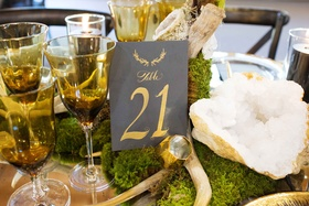 Rustic wedding with moss geode centerpiece grey table number with gold calligraphy