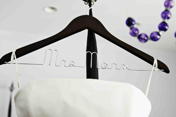 Bridal gown hanging on hanger with Mrs. personalization