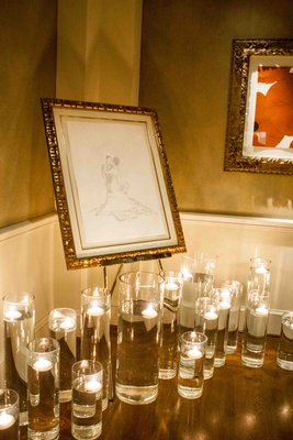 Hurricane vases with floating candles under custom drawing