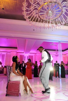 Kordell Stewart dancing around Porsha Williams at reception