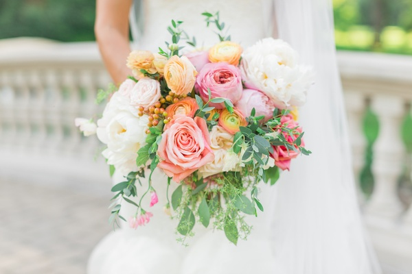 spring wedding bouquet with white, peach, yellow, and pink flowers