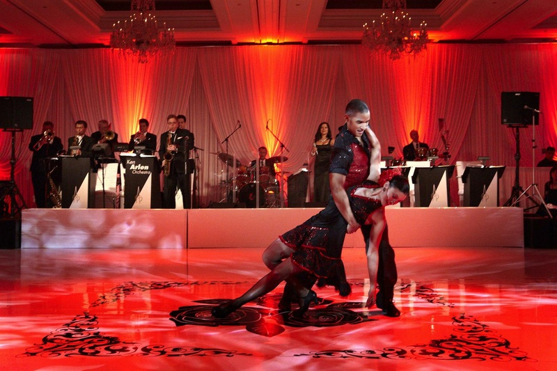 Red wedding reception lighting with professional dance entertainment