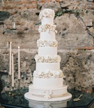 white wedding cake for destination wedding in antigua guatemala sugar flower layers between each