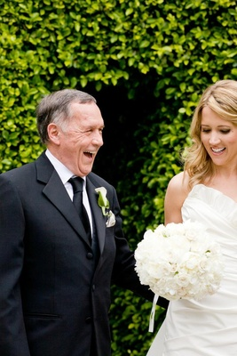 Bride smiles with her dad on wedding day