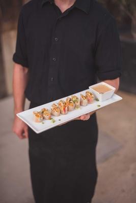 crab summer roll, rice paper, daikon, cucumber, carrot, Thai basil, nuoc chom vinaigrette on tray