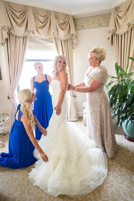 bride in vera wang, mother of the bride in liancarlo, bridesmaids in bill levkoff