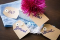 Tags on boxes for bride's something old, something, new, something borrowed, something blue
