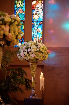 Wedding ceremony arrangement of pink and green flowers