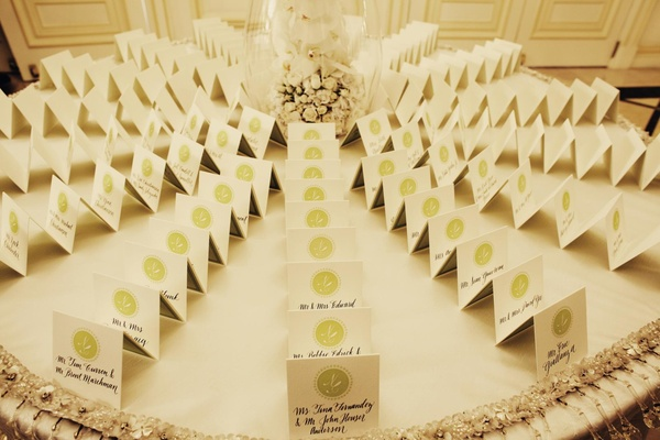 Wedding seating cards in calligraphy with green monogram