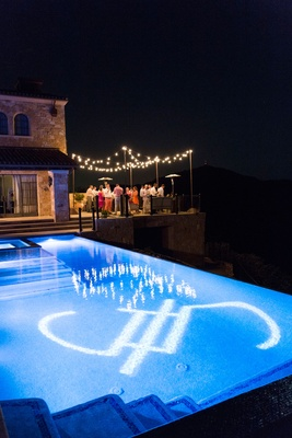 Wedding reception vineyard estate with pool reception tables patio lights gobo lighting projection