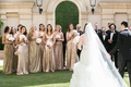 back view of bride and groom holding hands walking towards bridesmaids in gold sequin dresses