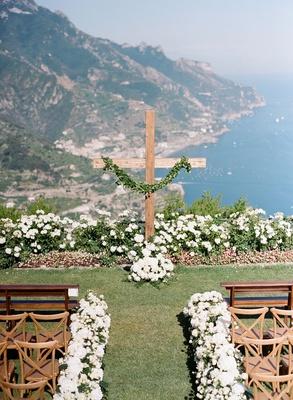 Wedding ceremony outdoor italy amalfi coast destination white flowers tan vineyard chairs pews bench