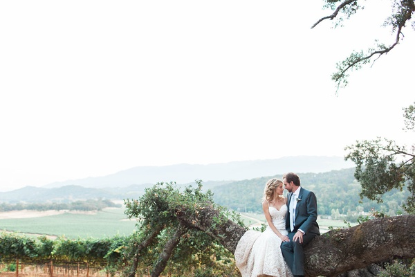 Bride and groom smiling at each other after rustic wedding with gorgeous scenery California rustic