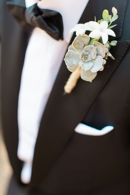 Groom with bow tie and tuxedo with rustic boutonniere succulent twine stephanotis greenery