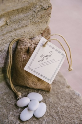 tiny burlap bag with candy-coated almonds and grazie tag
