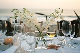Simple centerpiece with sand, starfish, and seashells