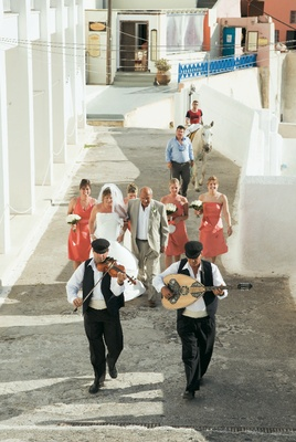 Traditional walk to ceremony in Santorini, Greece