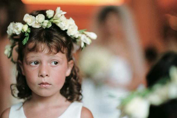 Flower girl wears flowers on head