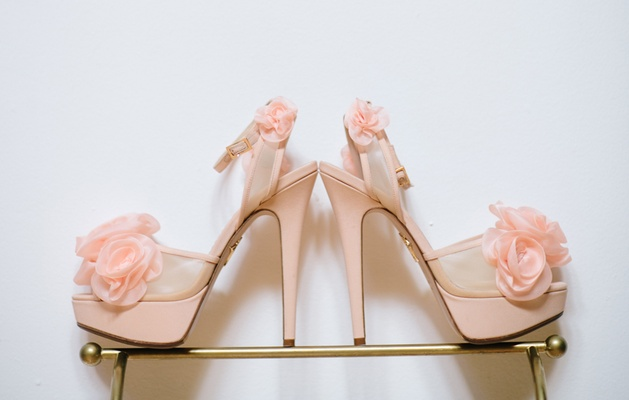 Pink heels with rosettes by Charlotte Olympia.