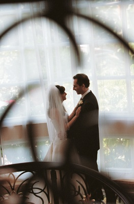 Wedding photo of bride and groom in hotel atrium