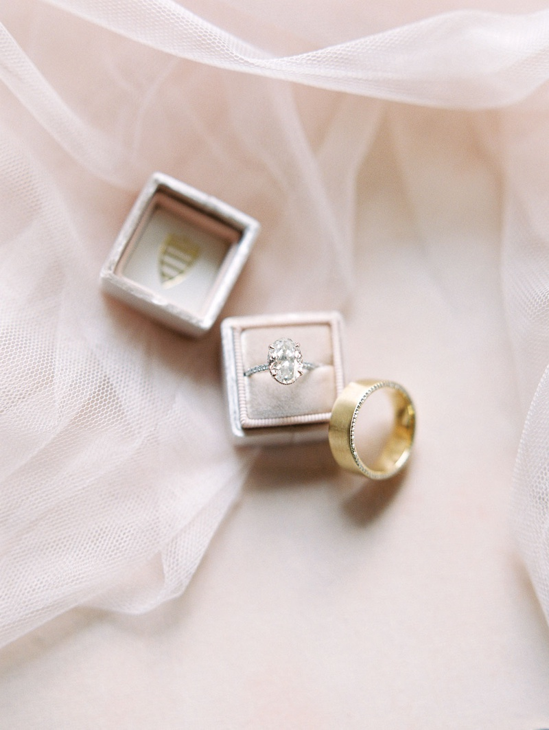 large oval diamond engagement ring with halo and pavé setting, wide yellow gold band