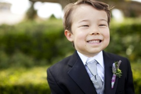 Young asian boy as ring bearer with lavender shirt