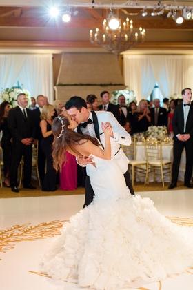bride in sparkling headband, ines di santo dress, groom in white tux jacket, kiss on dance floor