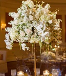 Orchid, rose, hydrangea wedding table centerpiece